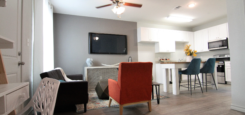 Renters love our open floor plans, like this living room and kitchen.
